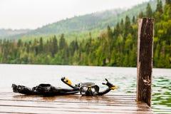 Snorkeling Mask and Tuba on Dock Stock Photo