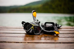 Snorkeling Mask and Tuba on Dock Stock Photos