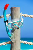 Snorkeling mask on wooden pier stake with ropes Royalty Free Stock Photography