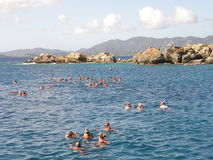 Snorkeling near the coast. A picture of a large group of people, enjoying a day of snorkeling in the calm waters off the coast Royalty Free Stock Photos