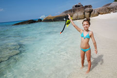 Snorkeling. Preteen child posing with snorkeling equipment on a tropical beach Royalty Free Stock Photos