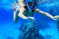 Snorkeling in red Sea. Young woman snorkeling near Tiran Island in Red Sea Stock Image