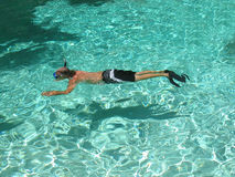 Snorkeling Ripple. Man snorkeling in crystal clear Hawaiian waters with ripples stock image