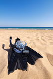 Snorkeling set lying on sand at seaside Royalty Free Stock Photo