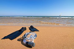 Snorkeling set lying on wet sand at seaside Royalty Free Stock Image