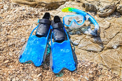 Snorkeling set and stony beach Royalty Free Stock Photography