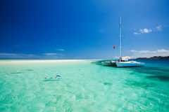 Snorkeling in shallow water off the catamaran stock photos