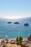 Snorkeling tourists and motor yachts on Red Sea Stock Photos