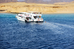 Snorkeling tourists and motor yachts on Red Sea Stock Photography