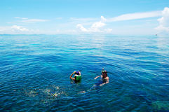 Snorkeling tourists on turquoise water of Indian Ocean Royalty Free Stock Photos