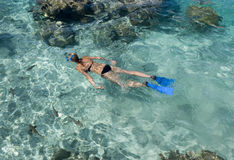 Snorkeling in a tropical lagoon - Bora Bora. Woman snorkeling in a tropical lagoon Bora Bora in the Islands of French Polynesia in the South Pacific Stock Photos