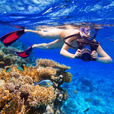 Snorkeling in the tropical water with camera Royalty Free Stock Photos