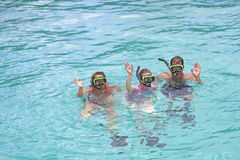 Snorkeling in the tropics. Family on vacation snorkeling in the tropics Royalty Free Stock Image