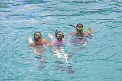 Snorkeling in the tropics. Family on vacation snorkeling in the tropics Stock Photo