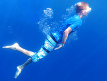 Snorkeling underwater. Underwater shot of a snorkeling young man Stock Images