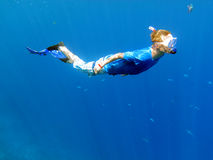 Snorkeling underwater. Underwater shot of a snorkeling young man Royalty Free Stock Photos