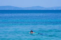 Snorkeling on a vacation at Aegean sea Royalty Free Stock Photo
