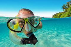 Snorkeling woman exploring beautiful ocean sealife. Under and above water photography. Travel lifestyle, water sport outdoor activities, swimming and stock image