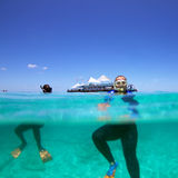 Snorkeling. Woman and men snorkeling on a coral reef Royalty Free Stock Image