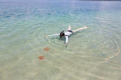 Snorkeling woman Stock Photo