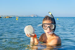 Snorkelinggirl with her find Stock Photography