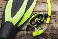 Snorkelling equipment on wood background Stock Photography