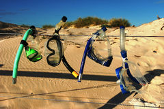 Snorkelling Gear Drying on a Wire Fence under blue sky at beach Royalty Free Stock Photography