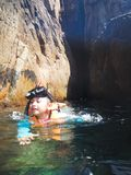 Snorkelling tourist at the caves of the Pulau Pinang on the island of Redang. royalty free stock photos