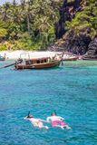 Snorkling. Couple snorkling in clear water of andaman sea Stock Image