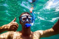 Snorkling man swim underwater. In turquoise sea Stock Photography
