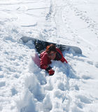 Snouboarder joven apenas caido Foto de archivo libre de regalías