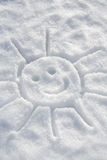 In the snow. Print of a happy sun in a snow royalty free stock photo