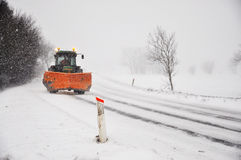 Snow. A snow plow driving on a road Royalty Free Stock Photography