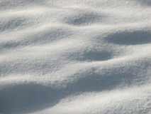 Snow. Abstract of snow with covered prints in sunshine stock images