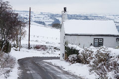 Snow. Ing on a country lane with the road clear Stock Photography