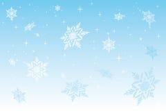 Snow. White snowflake on blue background Stock Photos