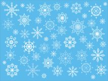 Snow. Blue background with white snowflakes Stock Photos