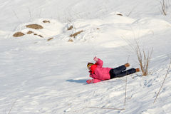 On the snow. A girl falling Royalty Free Stock Image