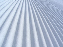 Snow. In stripes stock images