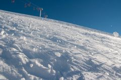 Snow. Pieces of snow coming down the slope royalty free stock photos