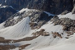 Snow accumulated under Glacier Angel. On Mount Edith Cavell Royalty Free Stock Photo