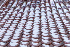 Snow accumulates on roof tiles Royalty Free Stock Photos