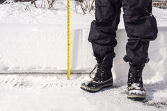Snow Accumulation is Measured with a Yellow Tape Royalty Free Stock Photography