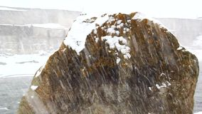 Snow  against the backdrop of a huge flying stone, snow stock video