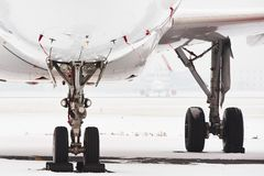 Snow at the airport. Aircraft covered by snow after a snow storm Royalty Free Stock Image