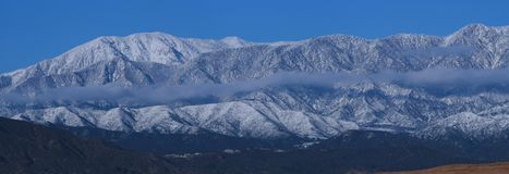 Snow along San Gorgonio Range 86-89. Snow covered mountains near Beaumont, CA Royalty Free Stock Photos