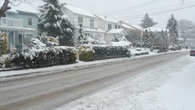 Snow along suburban street Royalty Free Stock Image
