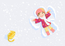 Snow angel. Pretty girl make wings on snow Stock Photos