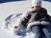 Snow Angel. Young girl making snow angels Royalty Free Stock Images