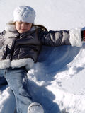 Snow Angel. Young girl making snow angels Royalty Free Stock Photos